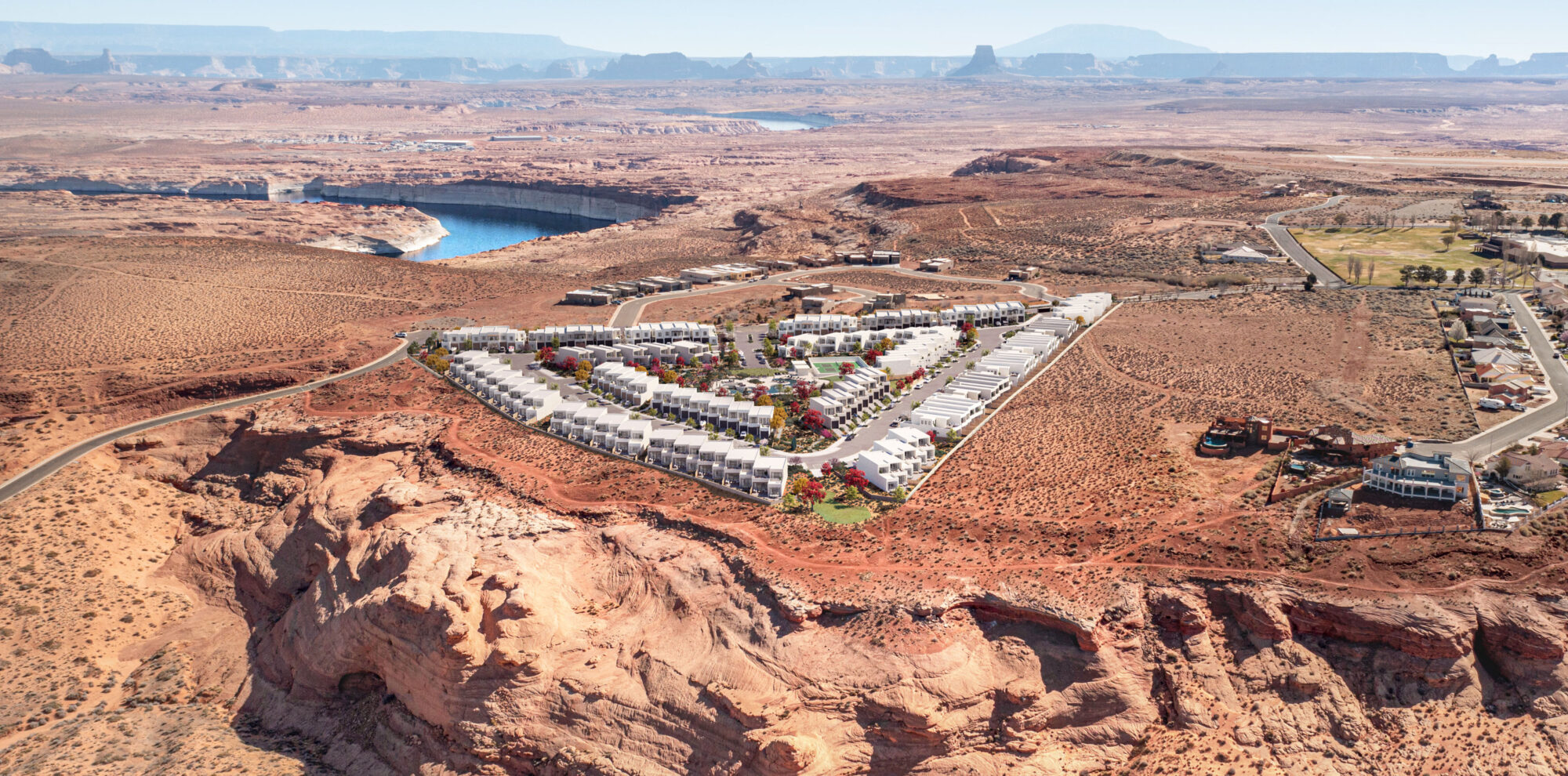 Aerial view of Indigo Ridge housing development with lake powell and navajo mountain in the distance