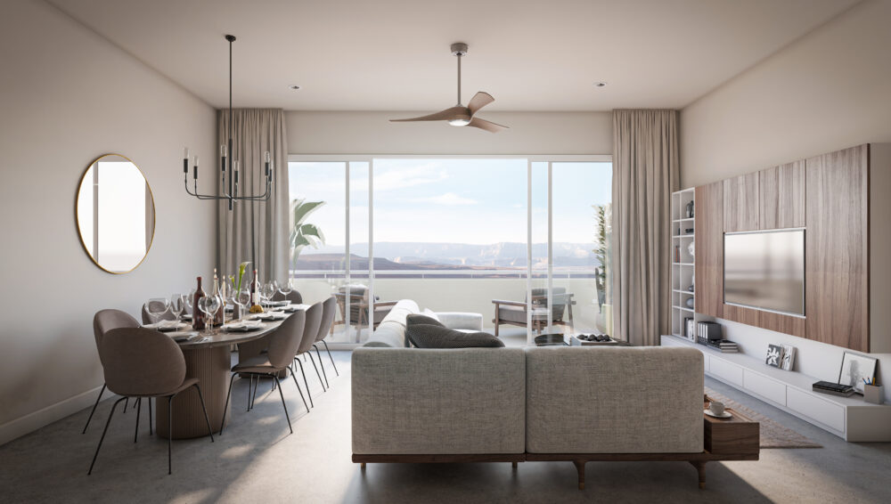 interior view of living and dining space looking out to arizona landscape in the distance